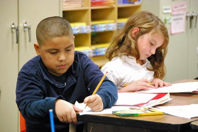 Third graders at Signal Hill Elementary work on a writing assignment. (Photo by Stephen Smith)