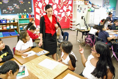 Jennifer Larsen guides her third grade class through a story-telling exercise. (Photo by Stephen Smith)