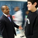 Millington Middle School principal Dr. Michael Lowe talks to one of his students in the hallway between classes. Lowe and both of his vice-principals evaluate each teacher and then combine the score. (Mike Brown/The Commercial Appeal)
