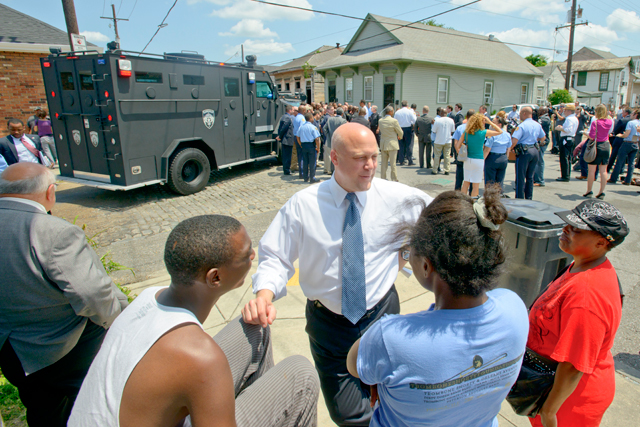 In this May 16, 2013. New Orleans Mayor Mitch Landrieu greets with residents before a news conference at North Villere and Frenchman Streets, where 20 people were shot in a the parade on Mother's Day in New Orleans. (AP Photo/Matthew Hinton, file)