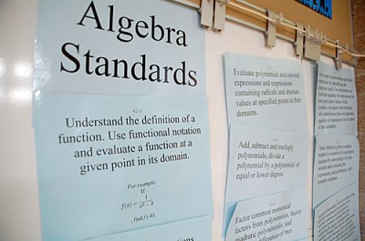 Minnesota's math standards hang at the front of a high school classroom in Bloomington. The state opted to stay with its own standards instead of adopting the national Common Core math benchmarks.  State education leaders say Minnesota's standards were more rigorous than the national standards. (Photo by Tim Post/MPR)