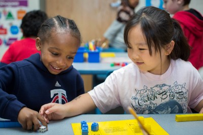 Kindergarten students Antwon Hollman, left, and Makayah Yang play a counting game Wednesday, June 5, 2013 in teacher Melanie Houff's class at Little Canada Elementary School. (Photo by Jennifer Simonson/MPR)