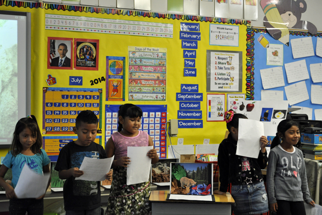 Lupita Martinez, 6, Aldo Ochoa, 6, Alison Teran, 6, Arlene Molina, 5, and Alessandra Almendariz, 6, worked as a team to research brown bears during a summer enrichment class at Carver Elementary in Santa Ana Unified. The students here are practicing oral and PowerPoint-style presentations with classmates in preparation for delivering their results to community members.