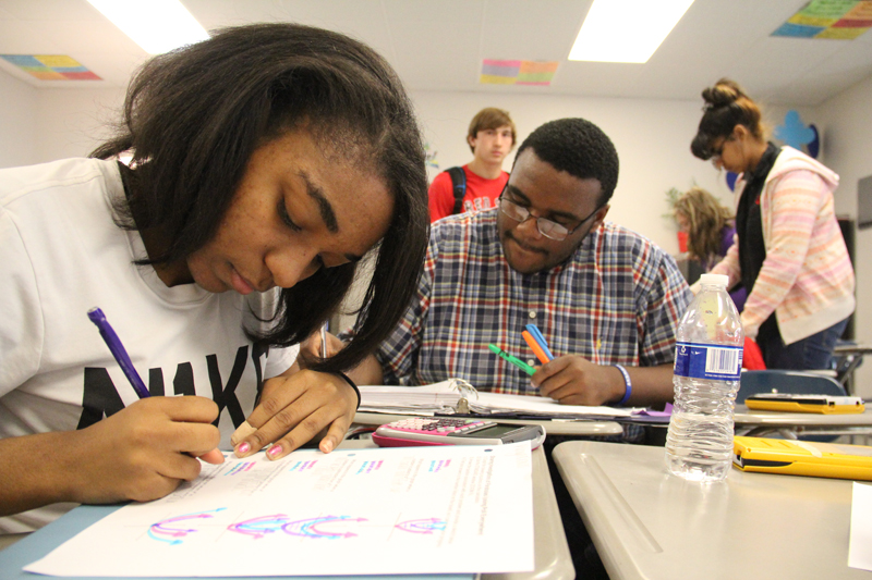 Students in Molly berry's algebra class work on an assignment together. When the state took control of the district in 2009, the pass rate on the high school algebra exit exam was only 45 percent. (Photo: Jackie Mader)