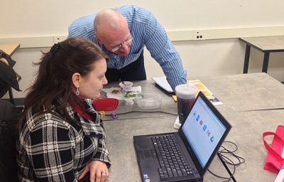 Tim Thomas (Hereford MS Library Media Specialist) and Lisa Dai Venker (Golden Ring MS Library Media Specialist)at a professional development meeting for middle school library media specialists in Baltimore County.