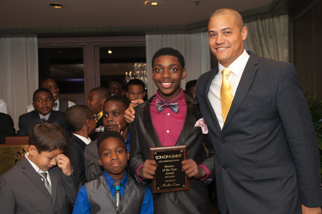 """Bivian """"Sonny"""" Lee III, founder of Son of a Saint, with boys in the program. (Photo: Kimberly LaGrue)"""