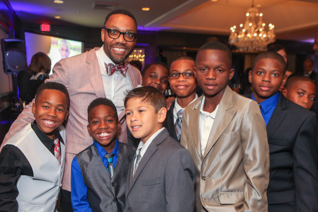 Andre Perry with boys in the Son of a Saint program (Photo: Kimberly LaGrue)