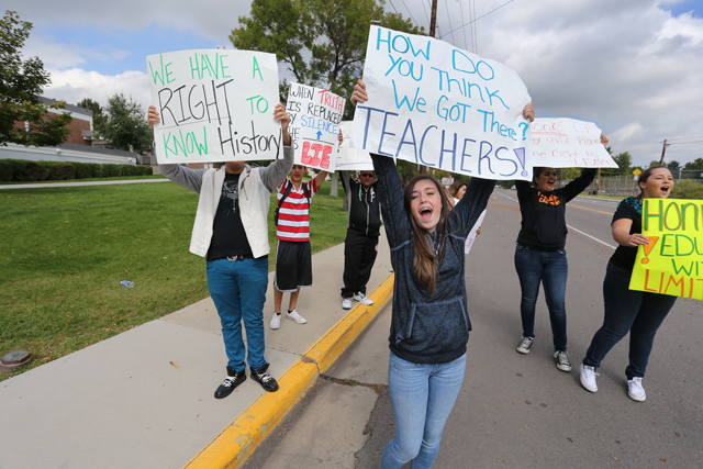 Students protest against a Jefferson County School Board proposal to emphasize patriotism and downplay civil unrest in the teaching of U.S. history, in front of their school, Jefferson High, in the Denver suburb of Edgewater, Monday, Sept. 29, 2014. (AP Photo/Brennan Linsley)