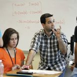 Orlando Sarduy is a math teacher at Coral Reef Senior High. He can understand the basics of the new, complex equation that will grade him and thousands of other teachers across Florida. But it won't grade him as a math teacher -- it will be tied to the school's FCAT reading scores. As Sarduy notes, the new evaluation system is one big experiment. Sarduy works with math students, Oct. 31, 2011. (CHARLES TRAINOR JR / MIAMI HERALD STAFF)