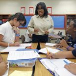 "Ponce de Leon Middle School math teacher Phyllis Bellinger talks instructs (left to right) Denis Pacheco, Isabel Canizares, Jamie Brown and Javier Martinez. When Miami-Dade public schools rolled out their performance pay plan to fanfare and cheering last year, it was the first district in Florida to get a head start on what will become a mandated policy in 2014 and felt like it took on frontrunner status in the nation. ""We're on the cutting edge for a large urban district,"" said Enid Weisman. Spurred on largely by competition for federal grants, the vast majority of states are in the midst developing performance pay models. Miami's system is a classic one as far as implementation goes with bonuses rewarded based on student performance on tests; its the kind that research has found doesn't make a significant change in student performance. So just where exactly does Miami rank among its national peers? With a sensitivity paid to getting teacher feedback and taking a multi-year approach to changing the culture, it holds more promise than failed ones in places like New York. But by sticking to test scores as the only variable, Miami is a step behind the multi-layered approaches in places like Denver and Austin. (Al Diaz / Miami Herald Staff)"